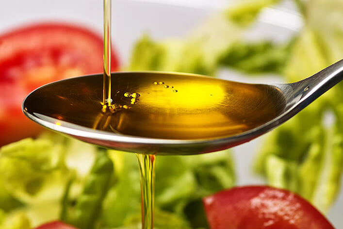 How much olive oil should I eat a day?